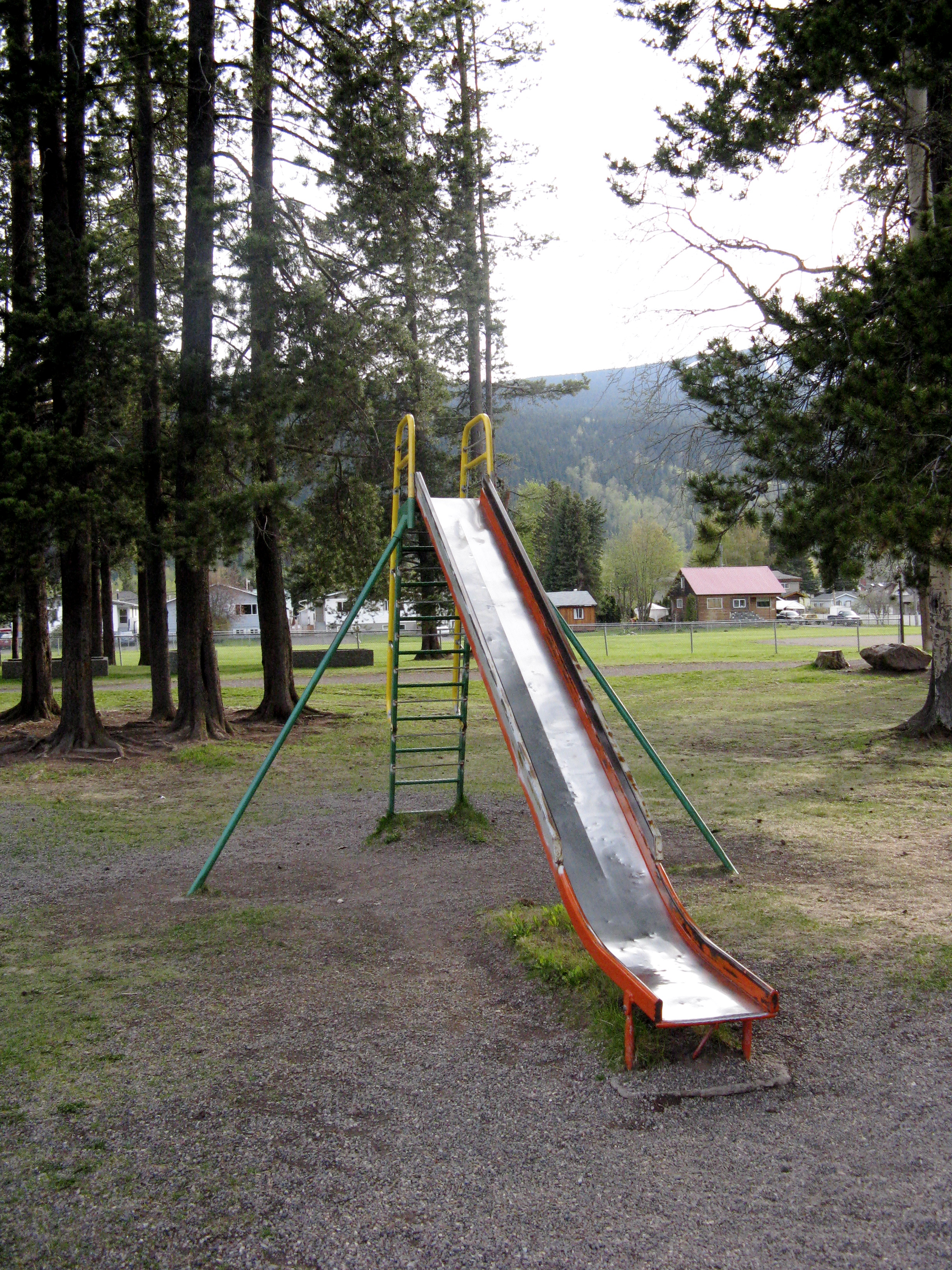 Cached Old-fashioned metal playground slides